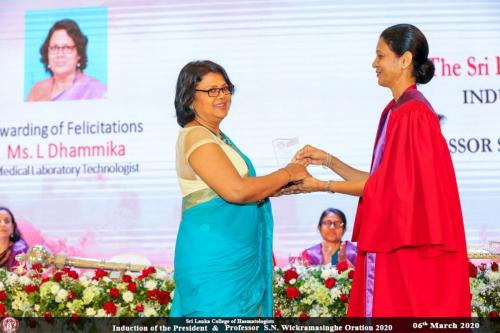 Felicitating Ms. L. Dhammika